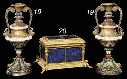 A pair of parcel-gilt silver,