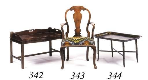 A walnut open armchair