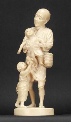 A Japanese okimono of a father