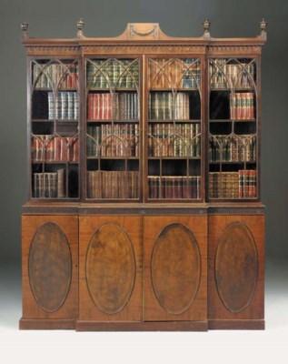 A mahogany breakfront bookcase