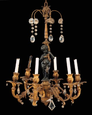 A gilt and patinated bronze si