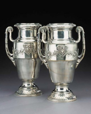 A pair of silvered metal vases