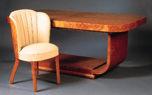 A BURR-WOOD DINING SUITE