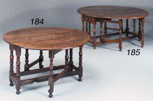 AN OAK DOUBLE GATELEG TABLE, E