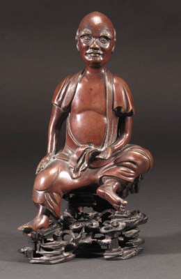 A Chinese bronze model of a se