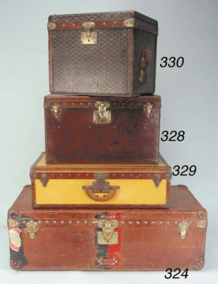 A small Louis Vuitton trunk of