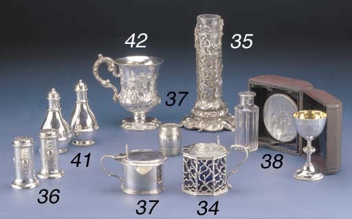 A VICTORIAN CASED SILVER TRAVE