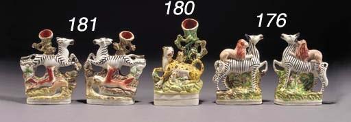 A spill vase group of a leopar