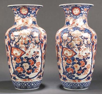 A large pair of Imari vases 19