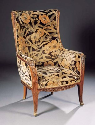 A CARVED AND UPHOLSTERED ARMCH