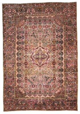 An antique Kirman Laver carpet