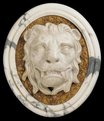 A pair of marble wall plaques,