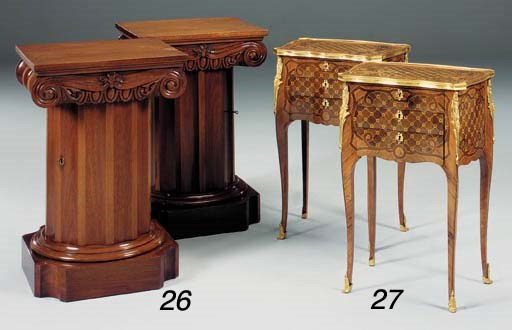 A pair of mahogany pedestal ca