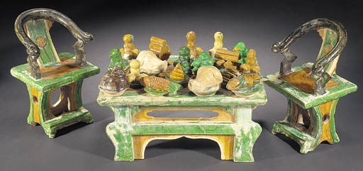 A Ming green and ochre glazed