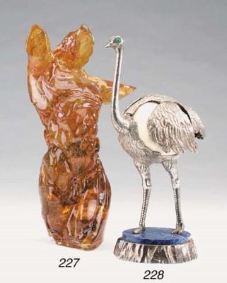 A silvered metal ostrich centr