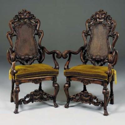 A pair of walnut open armchair