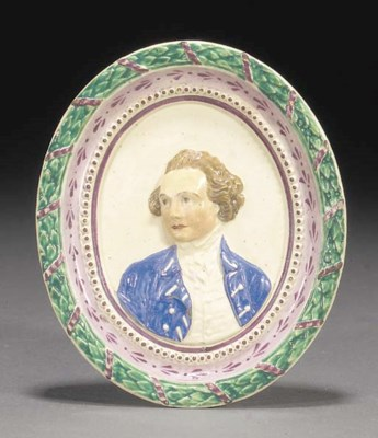A creamware oval plaque