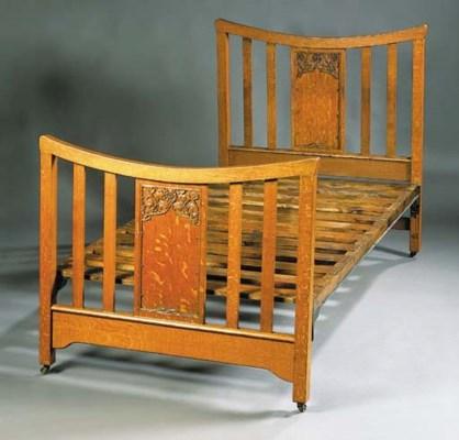AN ARTHUR W. SIMPSON OAK BED