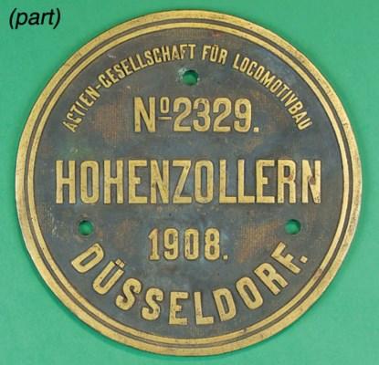 A circular bronze locomotive p