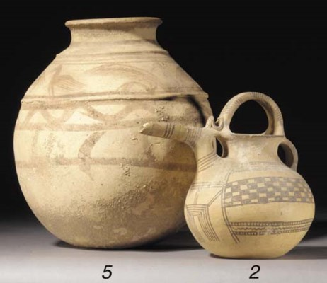 A LARGE PERSIAN POTTERY PAINTE