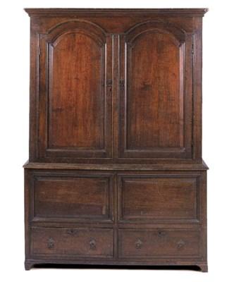 An oak press cupboard