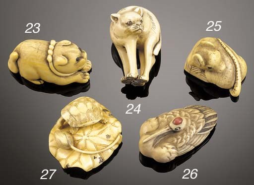 An ivory netsuke of a hound Ea