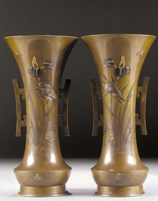 A pair of flaring patinated br