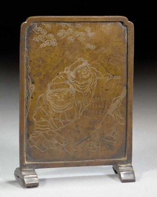 A miniature bronze table scree