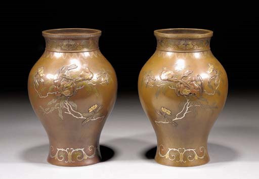 A pair of bronze inlaid balust