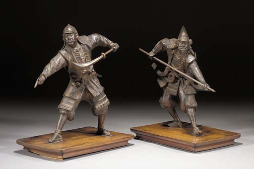 A pair of bronze models of war