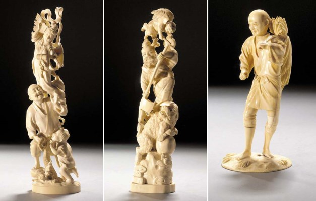 An ivory okimono of a farmer 1