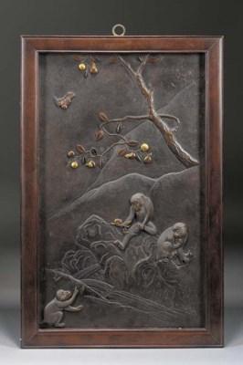 A bronze and iron rectangular