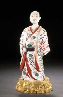 An Imari model of a standing d
