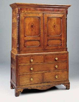 AN OAK AND INLAID LINEN PRESS,