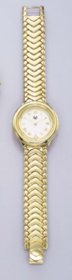AN 18K GOLD WRISTWATCH, BY GRA
