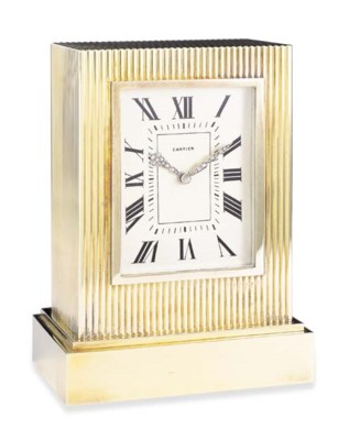 A GOLD TABLE CLOCK, BY CARTIER