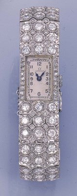 A DIAMOND BRACELET WATCH, BY O