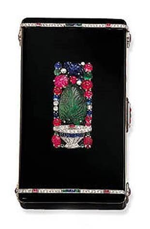 A rare Art Deco enamel and multi-gem Tutti Frutti vanity case, by Cartier, signed Cartier, Paris, London, New York, No. 9513a, circa 1925. 9 x 5 x 1.5  cm, with French assay marks. Sold for CHF99,875 on 17 May 2001  at Christie's in Geneva