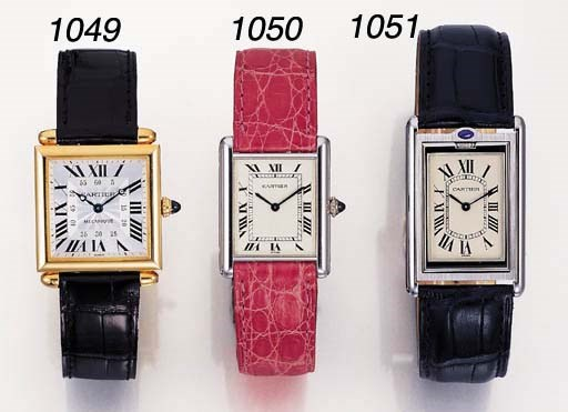 CARTIER. AN 18K GOLD SQUARE WR