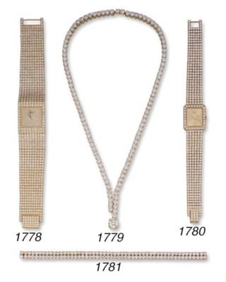 A DIAMOND BRACELET, BY MAUBOUS
