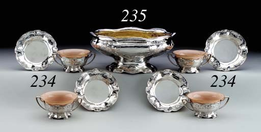 A SET OF TWELVE MARTELÉ SILVER