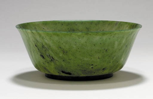 A Large Spinach-Green Jade Bow