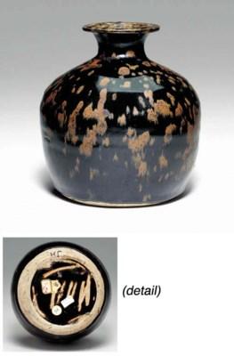A Rare Russet-Splashed Black-G