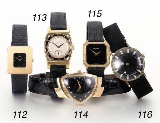 LeCoultre. A 14K gold and diam