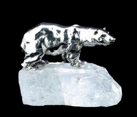 A SILVER MODEL OF A POLAR BEAR