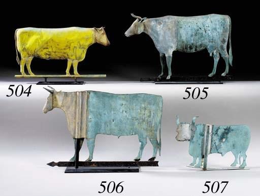 A CAST ZINC AND COPPER COW WEA