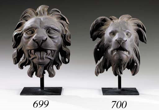 A CAST-IRON LION'S-HEAD ARCHIT