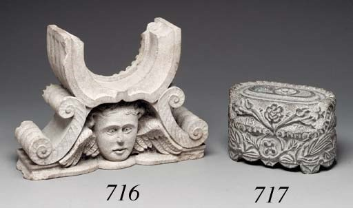 A CARVED STONE INKWELL