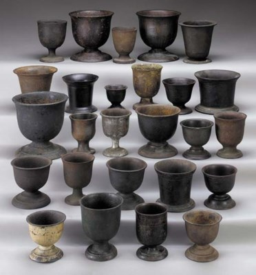A GROUP OF CAST-IRON MORTARS