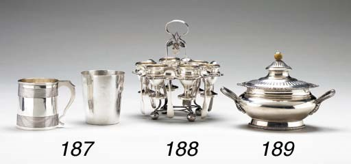 A SILVER EGGSTAND WITH SIX CUP